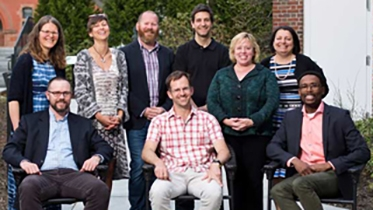 dartmouth professors smiling for camera